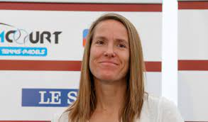 Justine Henin, a Belgian former professional tennis player known for her all-court style of play and notably being one of the few female players to use a single-handed backhand.