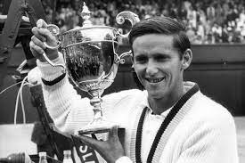 Roy Emerson, an Australian former tennis player who won 12 Grand Slam singles titles and 16 Grand Slam doubles titles, for a total of 28 Grand Slam titles.