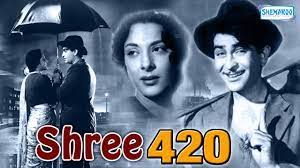 Shree 420, Raj falls prey to an unethical lifestyle when a rich businessman, Sonachand, lures him into it.